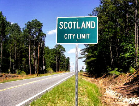 scotland ga city limit sign photograph copyright brian brown vanishing south georgia usa 2009
