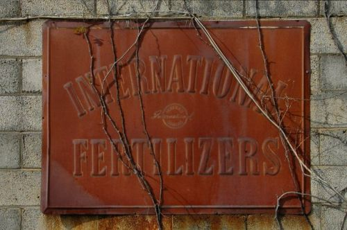 damascus ga international fertilizer sign photograph copyright brian brown vanishing south georgia usa 2010