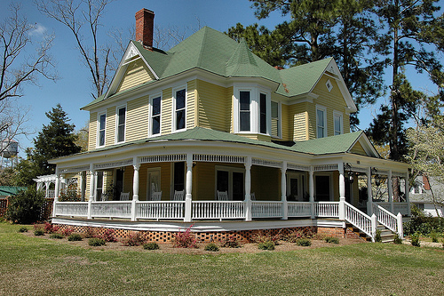 My dream house southern living and dream houses on pinterest - Yellow house with green roof ...