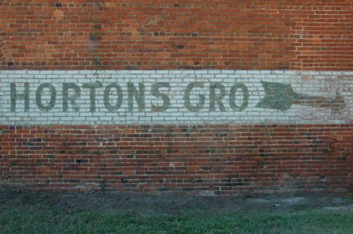 norristown ga farmers warehouse hortons grocery directional sign photograph copyright brian brown vanishing south georgia usa 2010