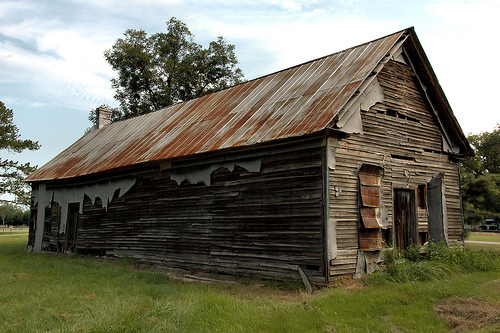 http://vanishingsouthgeorgia.files.wordpress.com/2010/09/cecil-ga-cook-county-ghost-town-abandoned-general-store-mercantile-rusted-tin-roof-landmark-pictures-photo-copyright-brown-vanishing-south-georgia-usa-2010.jpg