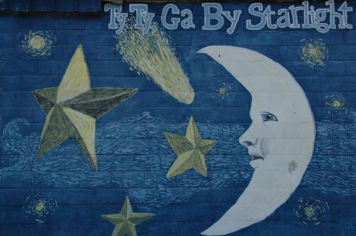 ty ty ga man in moon mural photograph copyright brian brown vanishing south georgia usa 2011