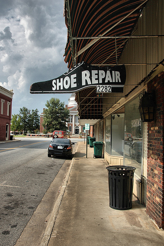 blakely ga shoe repair tradesman sign photograph copyright brian brown vanishing south georgia usa 2010