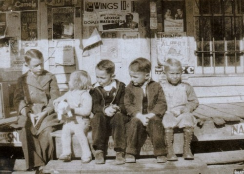 kids-sitting-on-the-front-stoop-of-the-kicklighter-store-hencart-road-tattnall-county-ga-circa-1937-photograph-copyright-bobby-c-kicklighter