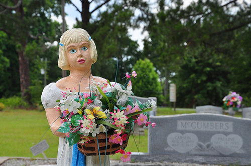 Cedar Crossing GA Toombs County Cemetery Decoration Young Girl in Dress Painted Statue Holding Basket of Flowers Picture Image Photograph © Brian Brown Vanishing South Georgia USA 2013