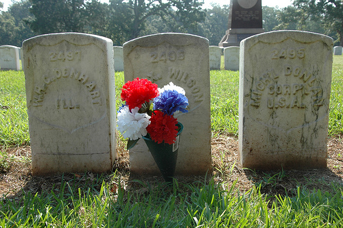 Andersonville GA National Cemetery Civil War Prison Camp Headstones with Red White Blue Silk Flowers Picture Image Photograph © Brian Brown Vanishing South Georgia USA 2013