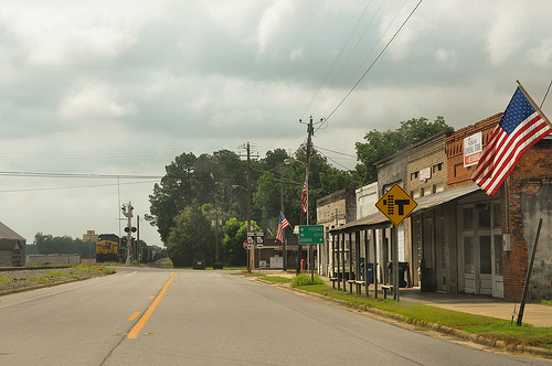 Patriotism Americana Flag Small Town Rebecca GA Turner County Train at Crossing Picture Image Photograph © Brian Brown Vanishing South Georgia USA 2013