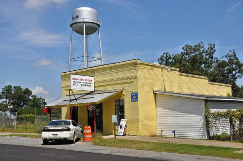 Arabi GA Crisp County Country Store Groceries Hardware Yellow Brick Water Tower Picture Image Photograph Copyright©  Brian Brown Vanishing South Georgia USA 2013