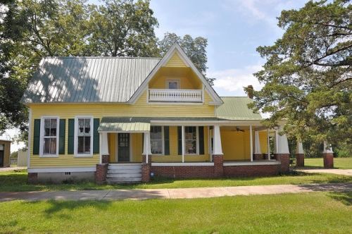Arabi GA Yellow Clapboard Vernacular House with Inset Second Floor Balcony Picture Image Photograph Copyright © Brian Brown Vanishing South Georgia USA 2013