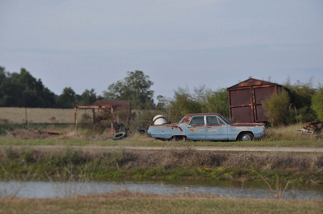 Abandoned plymouth fury iii lands crossing vanishing Usa countryside pictures