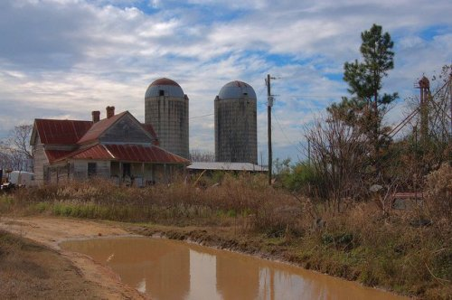 Family Farmstead with Silos Folk Victorian House Mud Puddle Jenkins County GA Photograph Copyright Brian Brown Vanishing South Georgia USA 2013