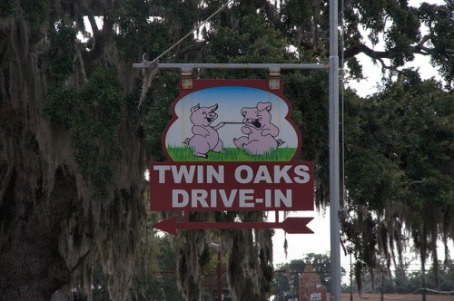 Twin Oaks Drive-In Restaurant Brunswick GA Funny Pigs Sign Landmark Photograph Copyright Brian Brown Vanishing South Georgia USA 2013