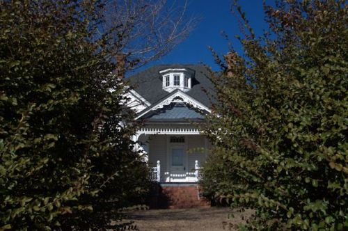 Stapleton GA Eclectic Victorian House Through the Camelia Hedge Photograph Copyright Brian Brown Vanishing South Georgia USA 2014