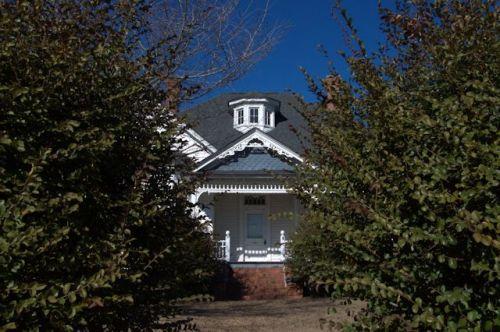 Stapleton GA Eclectic Victorian House Through the Camelia Hedge Photograph Copyright Brian Brown Vanishing South Georgia USA 2014