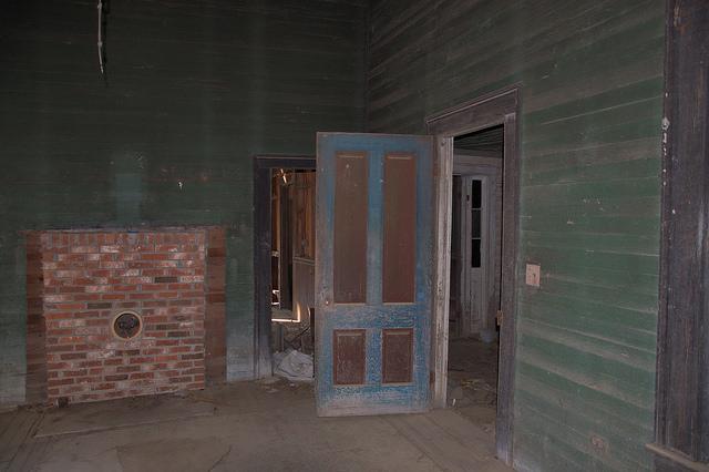 Abandoned Folk Victorian Farmhouse Interior Green Walls Blue Door Photograph Copyright Brian Brown Vanishing South Georgia