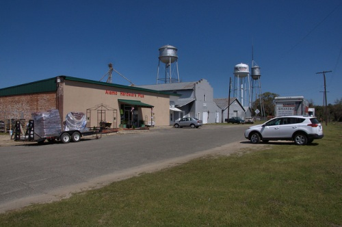 Alamo GA Wheeler County Hardware Store Agricultural Warehouses Water Towers Photograph Copyright Brian Brown Vanishing South Georgia USA 2014