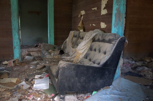 Screven County GA Abandoned Farmhouse Interior Bare Walls Haint Blue Trim Black Naugahyde Couch Sofa Photograph Copyright Brian Brown Vanishing South Georgia USA 2014
