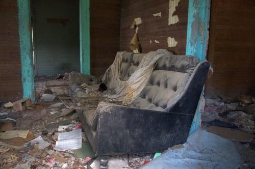 Screven County GA Abandoned Farmhouse Interior Bare Walls Haint Blue Trim Black Naugahyde Couch Sofa Photograph Copyright Brian Brown Vanishing South Georgia USA 2014