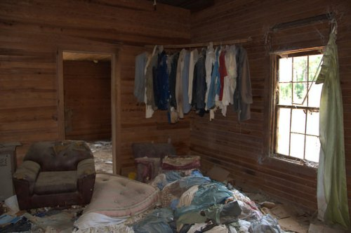 Screven County GA Abandoned House Interior Bare Walls Curtain Clothes Hanging in Corner Photograph Copyright Brian Brown Vanishing South Georgia USA 2014