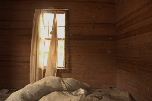 Screven County GA Abandoned House Interior Bare Walls Curtain Sunlight Blue Ticking Stripe Mattresses Photograph Copyright Brian Brown Vanishing South Georgia USA 2014