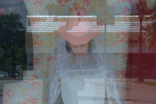 Sylvania GA Screven County Downtown Thrift Store WIndow Display Mannequin Wedding Dress Pink Cowboy Hat Photograph Copyright Brian Brown Vanishing South Georgia USA 2014