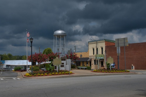 Sylvania GA Screven County Water Tower Restored Downtown Buildings Plaza Park Thunder Clouds Photograph Copyright Brian Brown Vanishing South Georgia USA 2014