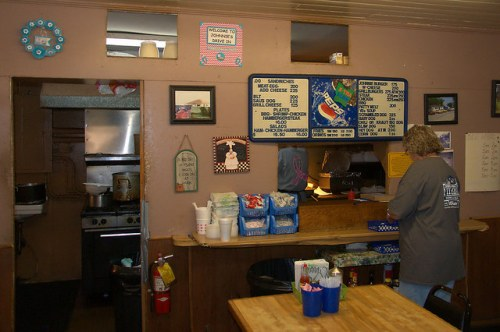 Johnnies Drive In Restaurant Fitzgerald GA Landmark Denise Picking Up an Order Photograph Copyright Brian Brown Vanishing South Georgia USA 2015