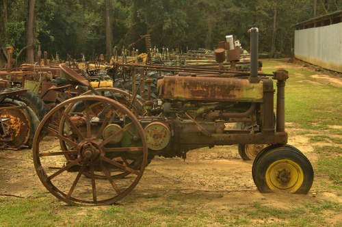 T&H Tractor Sales Salvage Pavo GA Antique Tractors Johne Deere Photograph Copyright Brian Brown Vanishing South Georgia USA 2015