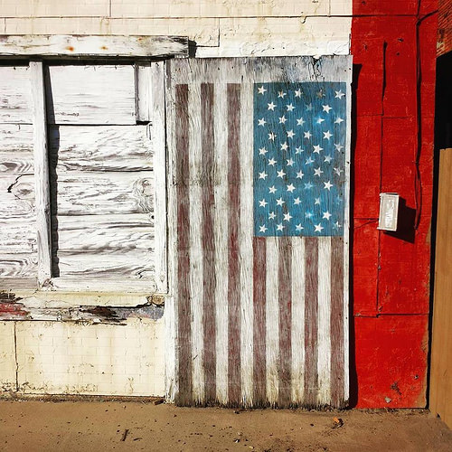 Lyons GA Toombs County Faded American Flag Folk Art Storefront Photograph Copyright Brian Brown Vanishing South Georgia USA 2016