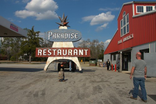 Bringing the Paradise Restaurant Sign Through Fuel America Parking Lot Cooperville GA Photograph Copyright Brian Brown Vanishing South Georgia USA 2016