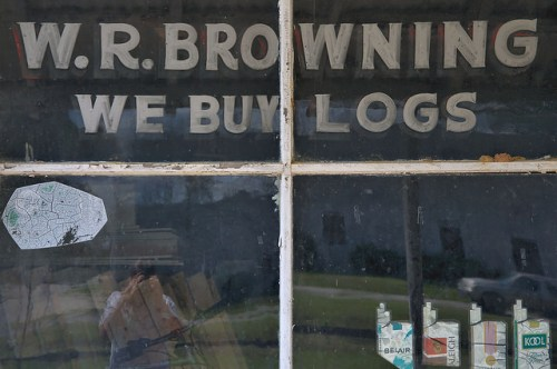 W R Browning General Store We Buy Logs Window Sign Photograph Copyright Brian Brown Vanishing South Georgia USA 2016